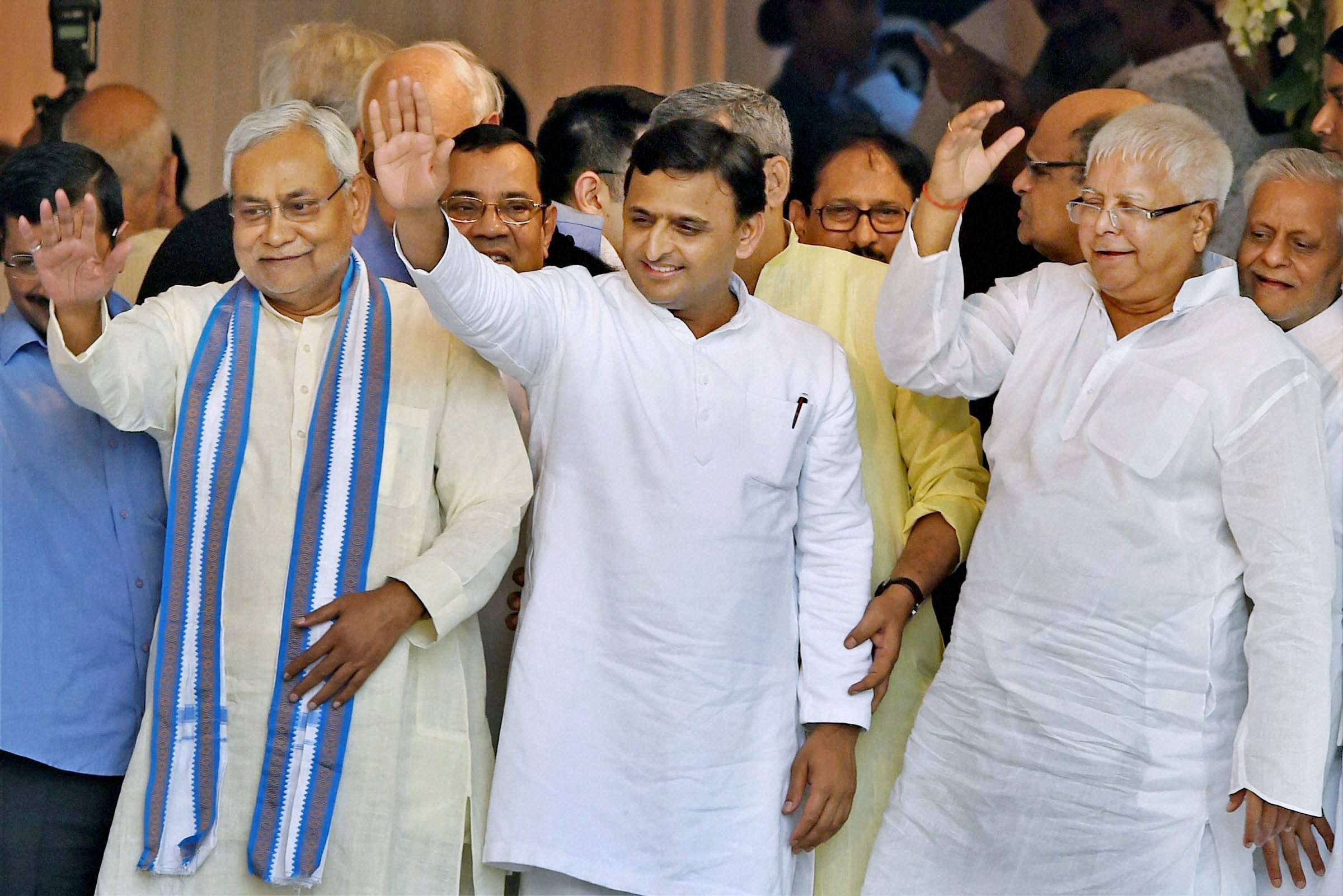 Nitish Kumar, Akhilesh Yadav and Lalu Prasad Yadav at Mamata Banerjee's swearing in ceremony as West Bengal chief minister. Image: PTI