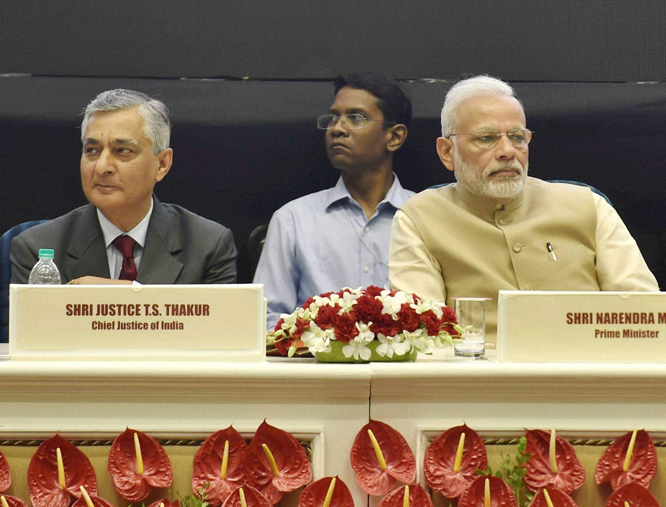Prime Minister Narendra Modi and Chief Justice of India TS Thakur during the 50th anniversary function of establishment of the High Court of Delhi. Photo: PTI