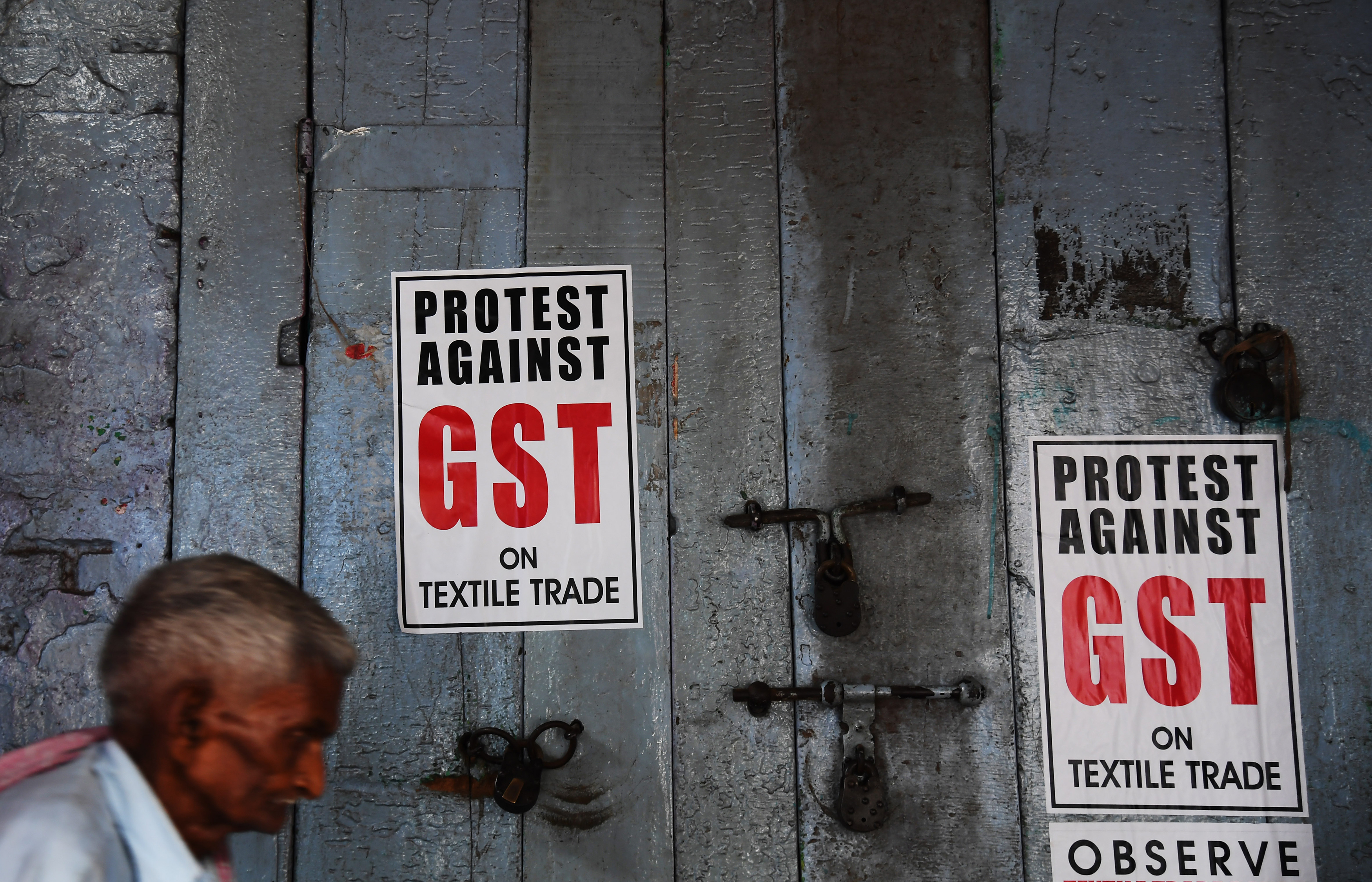 GST broke the backs of tens of thousands of small traders faced for the first time with a complex and expensive compliance burden. Photo credit: AFP