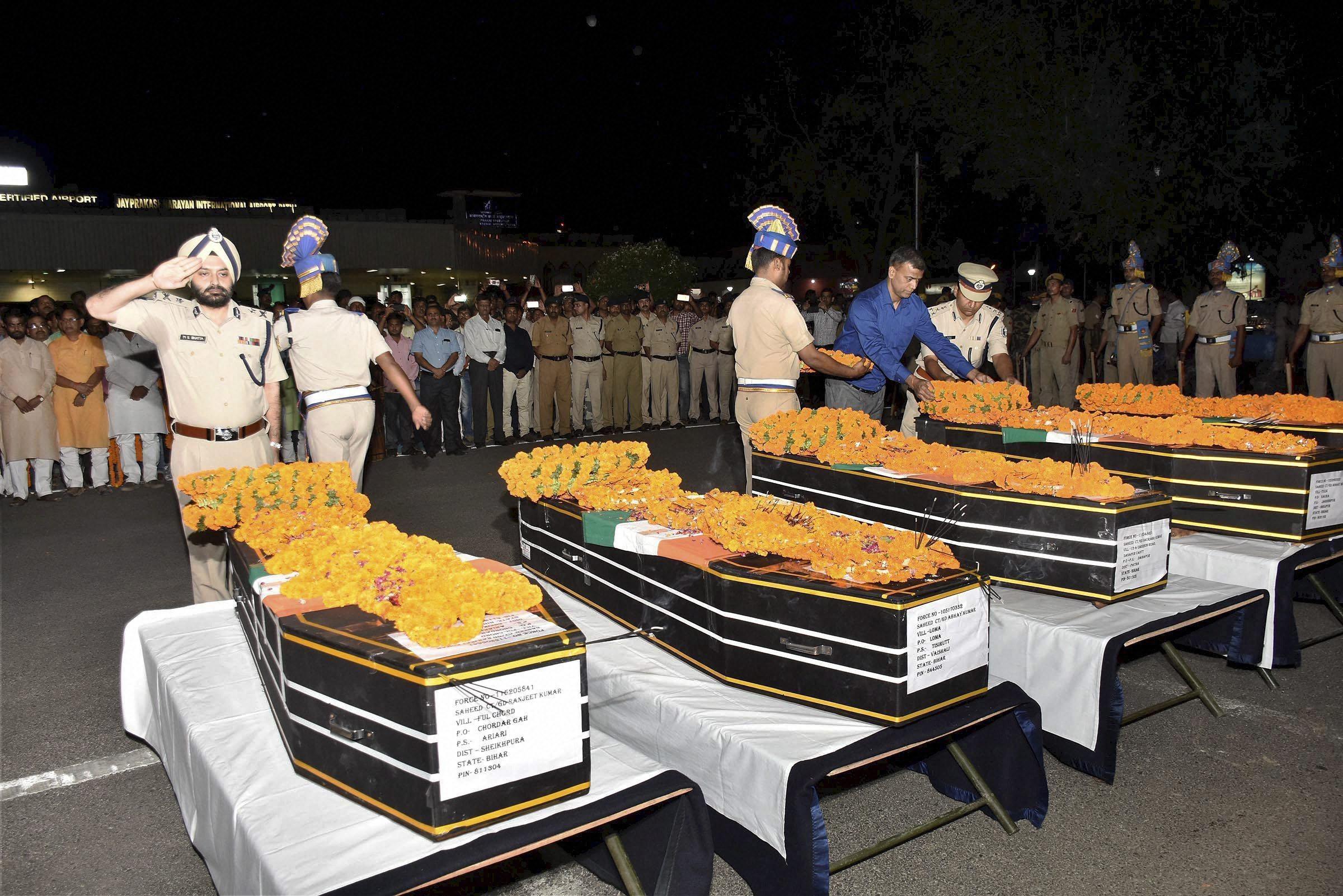 CRPF officers pay tributes to slain jawans at Patna airport. Image credit: PTI