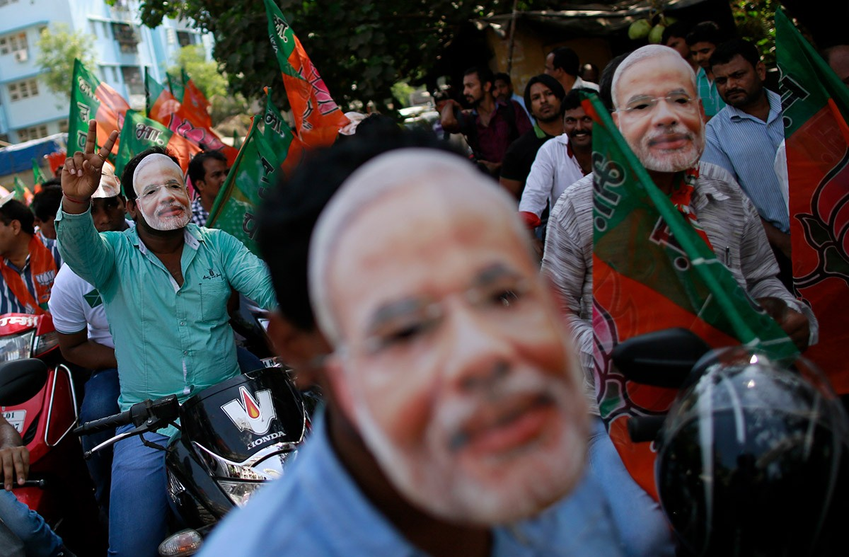 Supporters of the BJP participate in a celebration rally ahead of Narendra Modi's swearing-in in May 2014. Photo credit: Reuters
