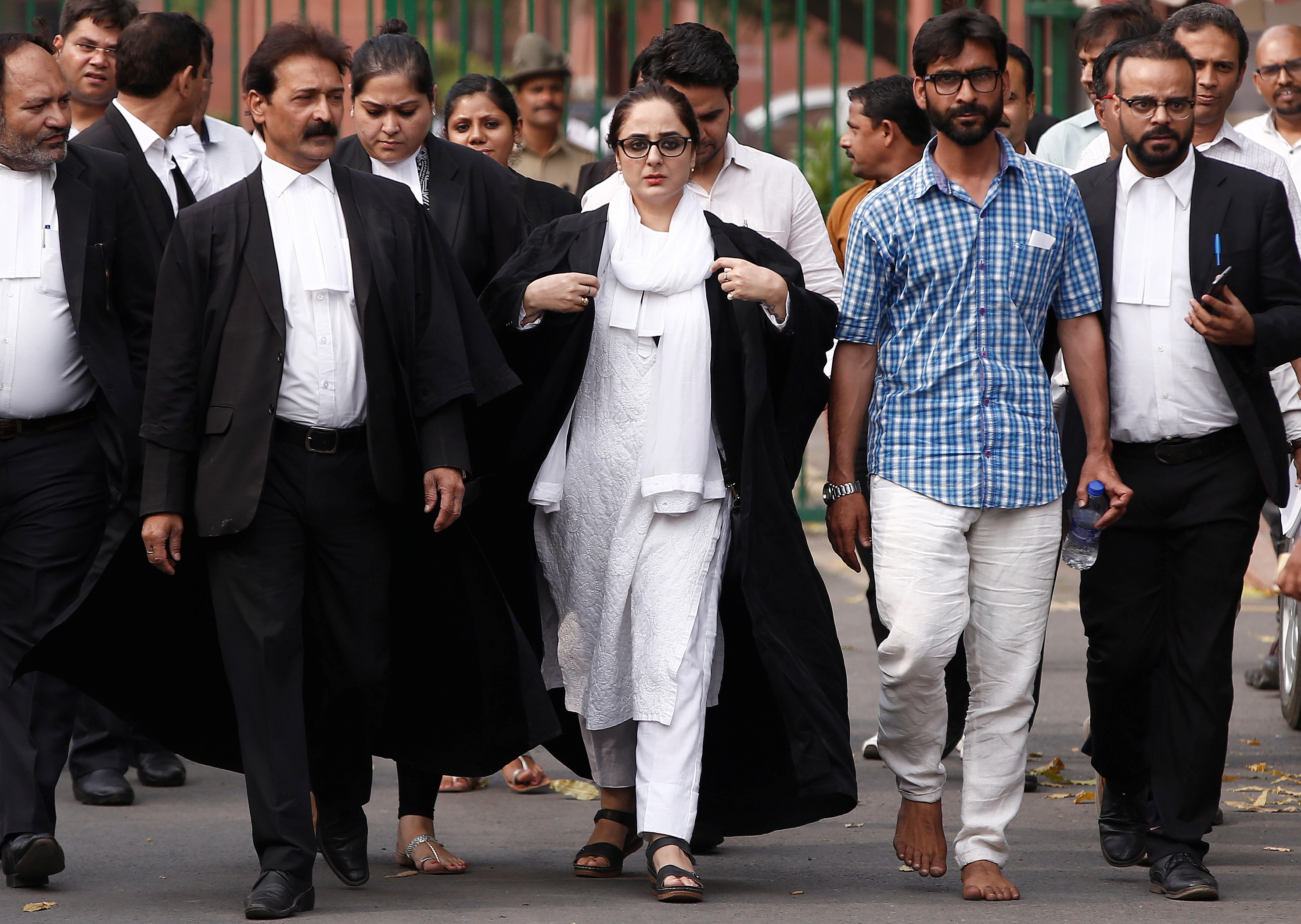 Talib Hussain, second right, with Deepika Singh Rajawat, the lawyer representing the Kathua victim's family. Photo credit: Reuters