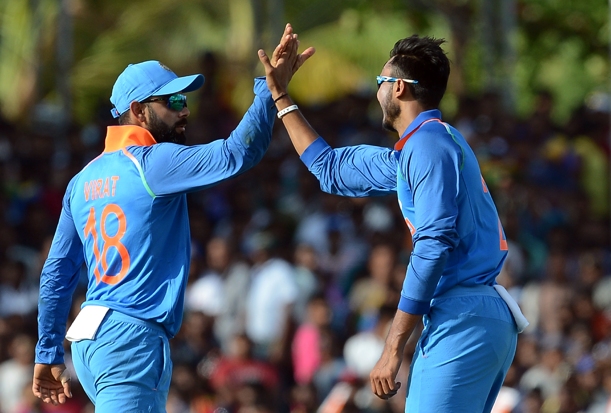 Axar Patel does a holding job but his style of bowling seems interchangeable with Ravindra Jadeja (Image credit: Lakruwan Wanniarachchi/AFP)