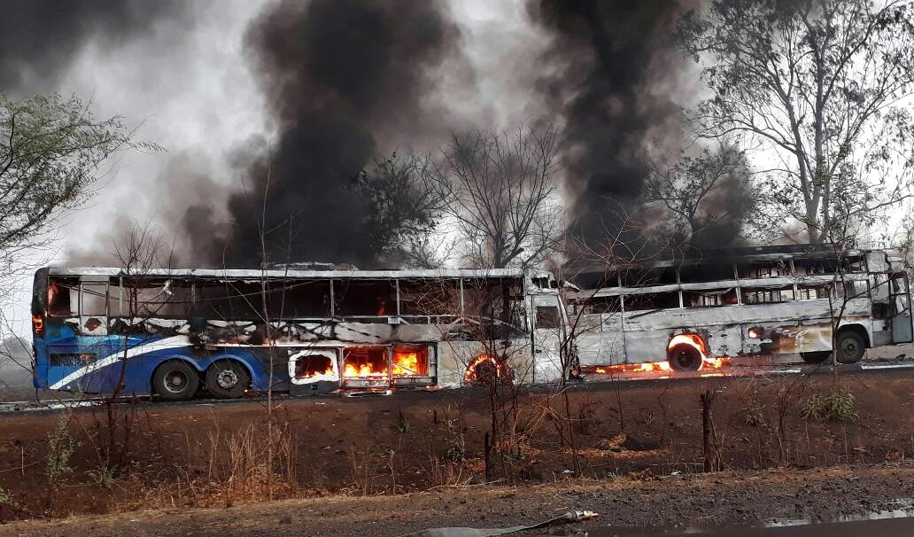 Buses set on fire by agitating farmers in Indore on Wednesday. Photo credit: IANS