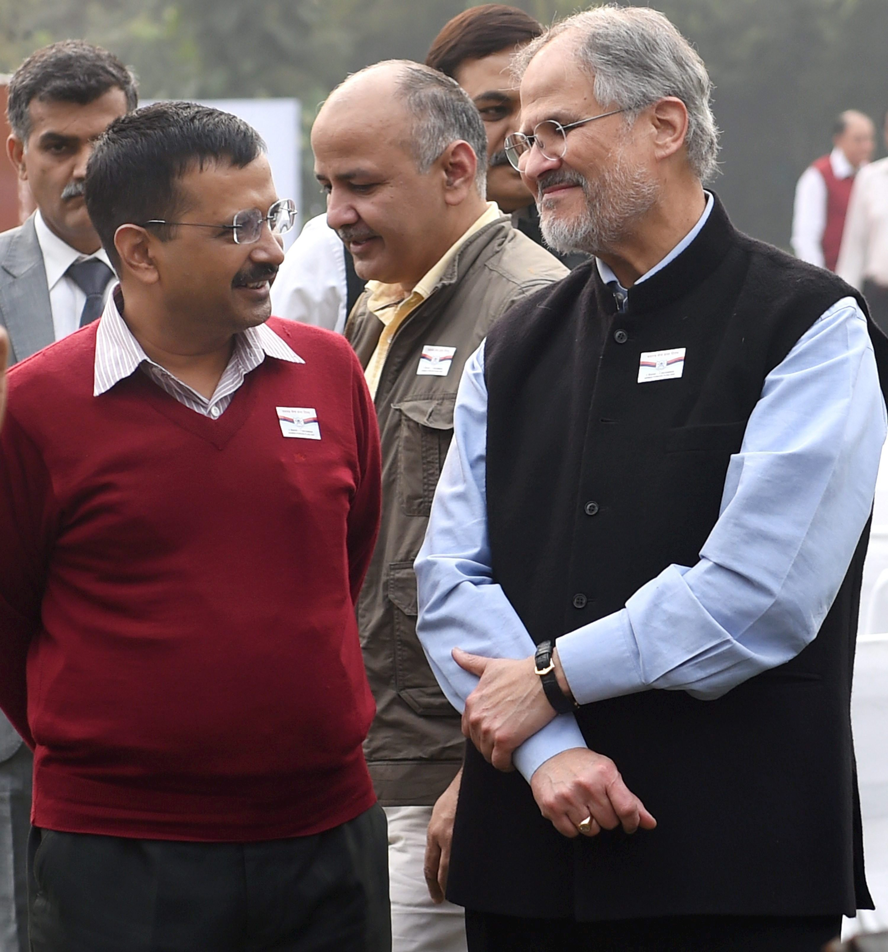 Delhi Chief Minister Arvind Kejriwal with outgoing Lt Governor Najeeb Jung. Image credit: PTI